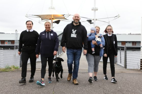 Ahead of their walk on Saturday from the Tay Bridge to the Queensferry Crossing, in aid of Andy's Man Club are from left: April Roberts, Val Lindsay, Ritchie Peter-Tennant, Chez Lesley with baby Lucas-Zak, and Brodie Hamill along with Skip the dog.