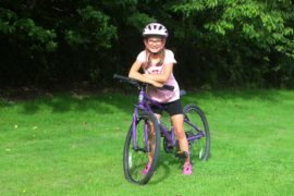 Katie has cycled 1000 miles on her favourite purple bike