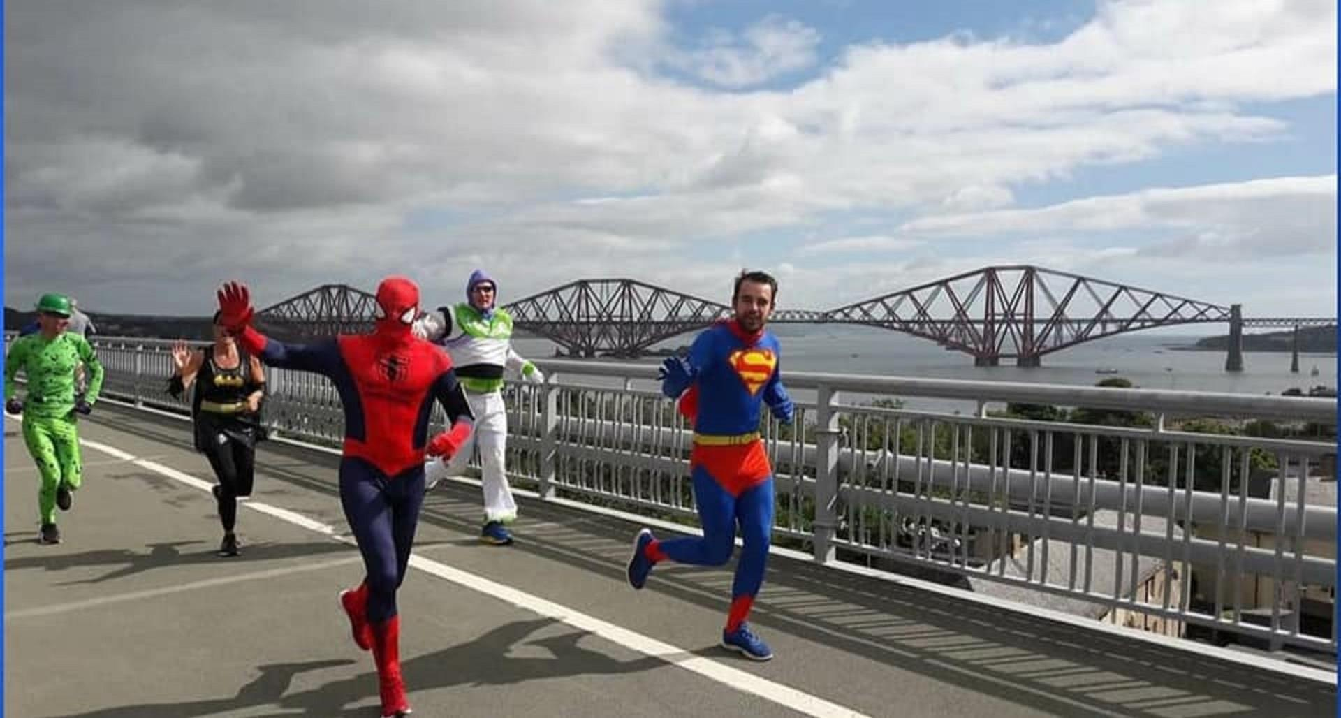 Dalgety Bay Superman supported  his pal Duloch Spiderman during the epic 49-mile charity run.