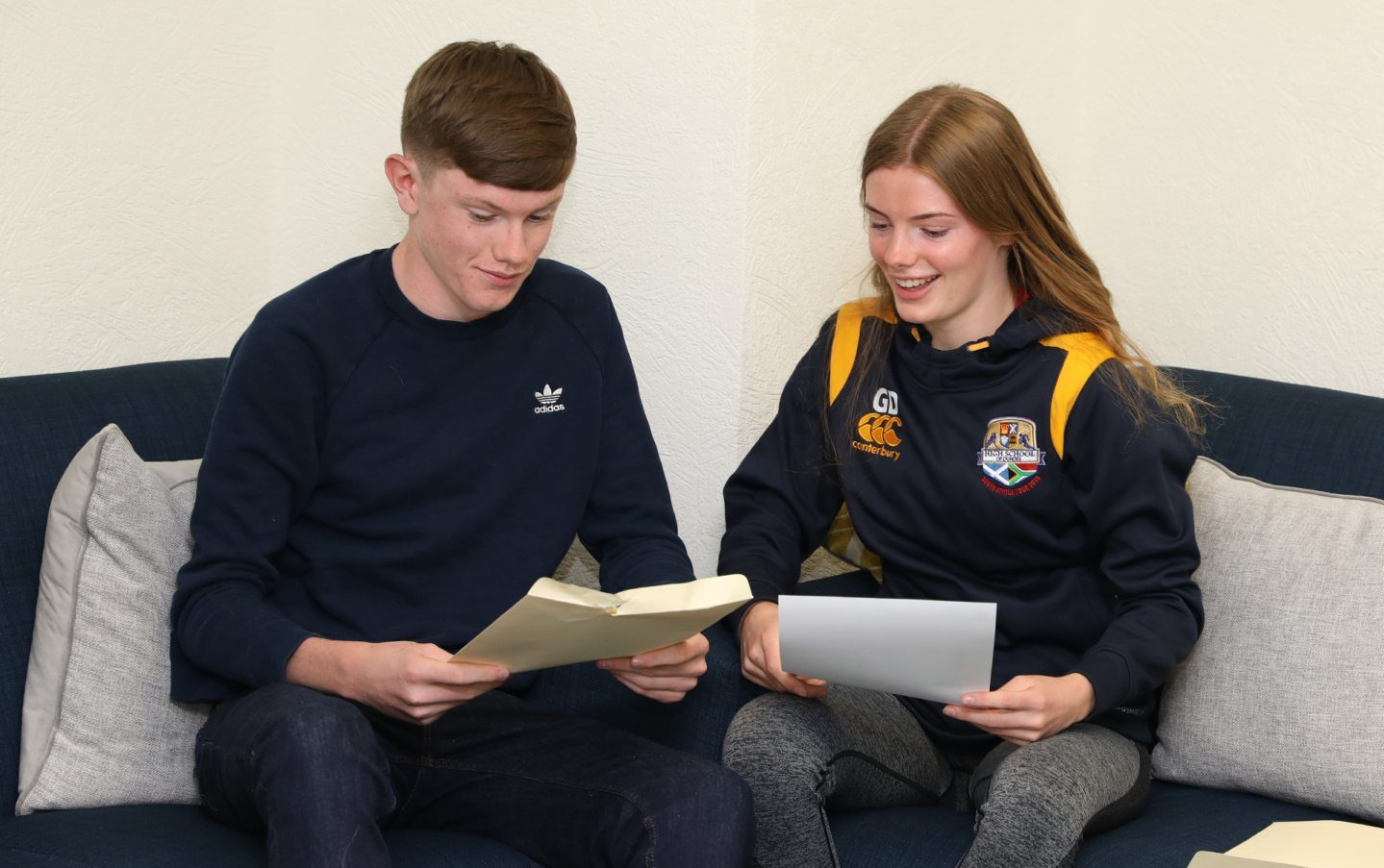 Brother and sister  Alex, 15, and Georgia  Douglas, 17, receive their results at Dundee High School.