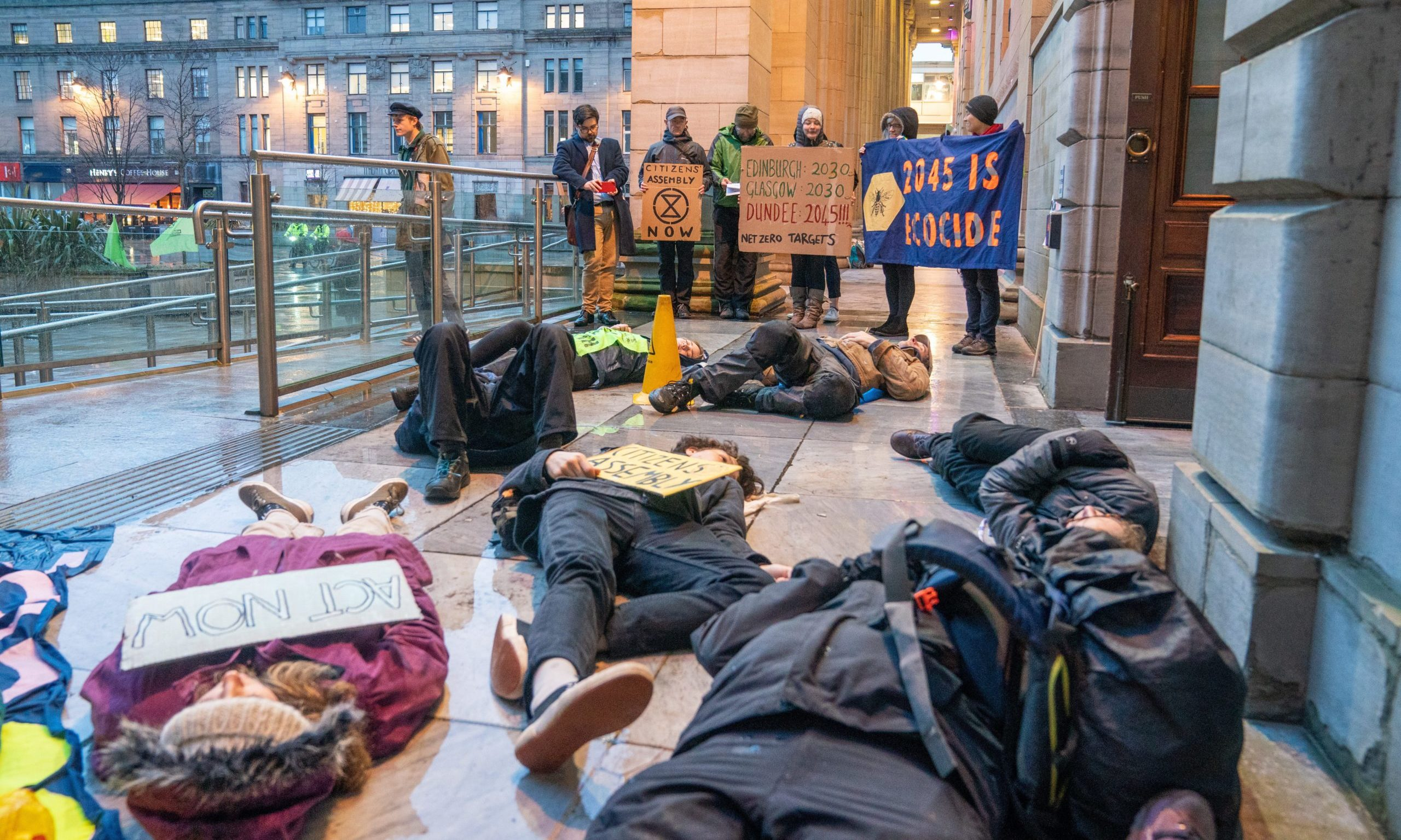 """Protestors hold a """"die-in"""" outside the city chamber earlier this year."""
