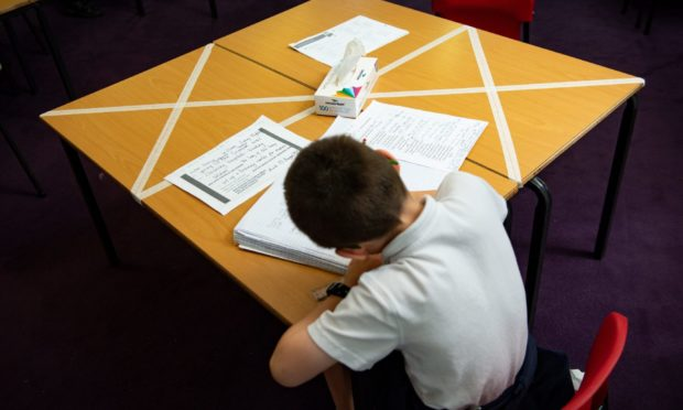A pupil works at school.