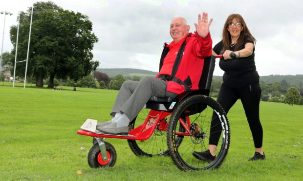 Cycling Without Age CEO Christine Bell takes 83-year-old Norman Ridley for a spin on the Paratreker Trail.
