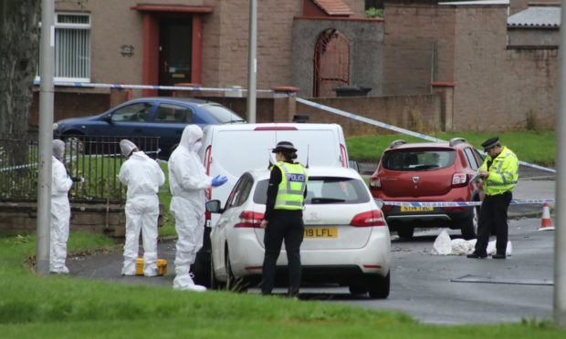Police in the Spittalfield area of Arbroath following the death of Frankie Melvin.