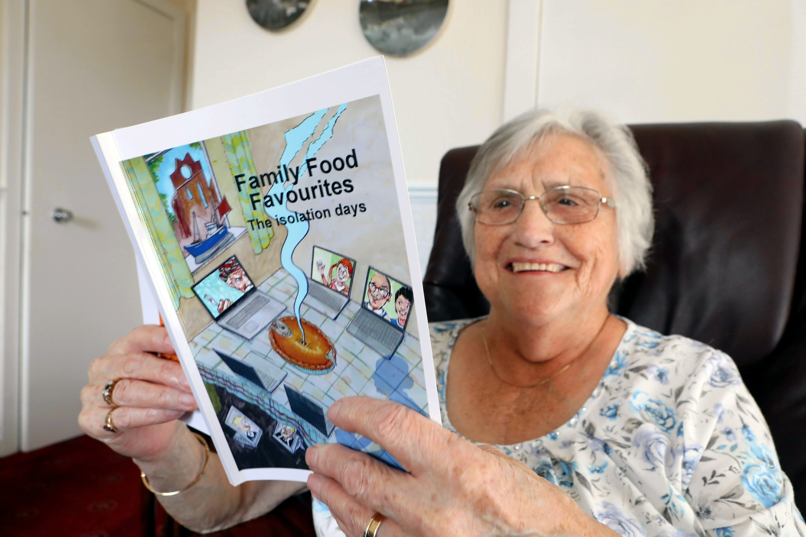 Marie Welsh of the Local People Project with the Family Food Favourites recipe book.