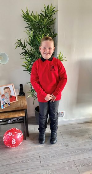 Harris Mitchell, age 8 heading off to Castlehill Primary School, Cupar