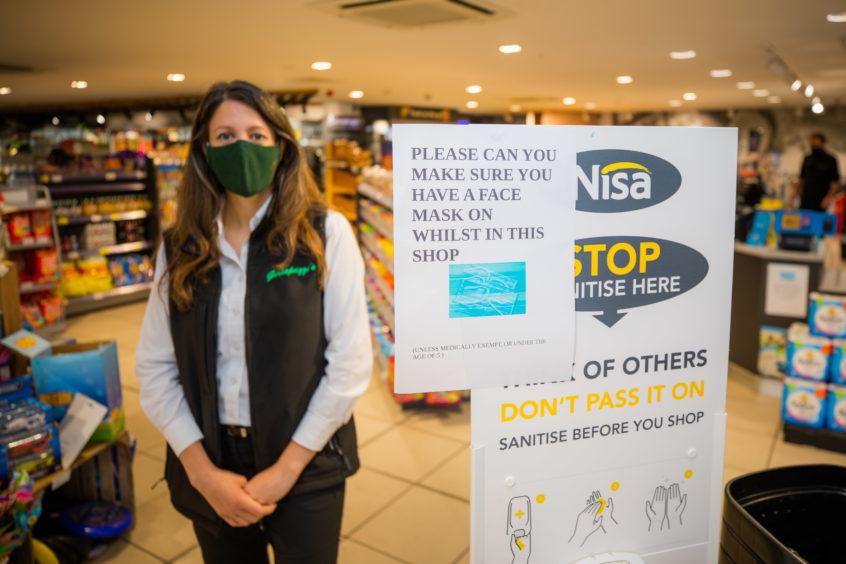 Kinross store owner Joanna Casonato wearing her mask.