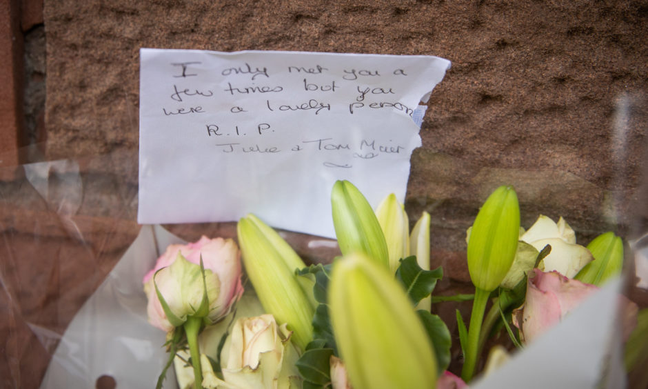 Floral tributes to the deceased left at Stonehaven Station.