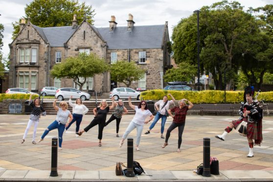 Friends of the bride perform their impromptu dance routine outside Kirkcaldy Town House.