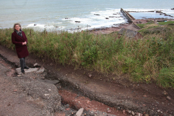 Angus councillor Lois Speed at the badly-eroded Auchmithie road.