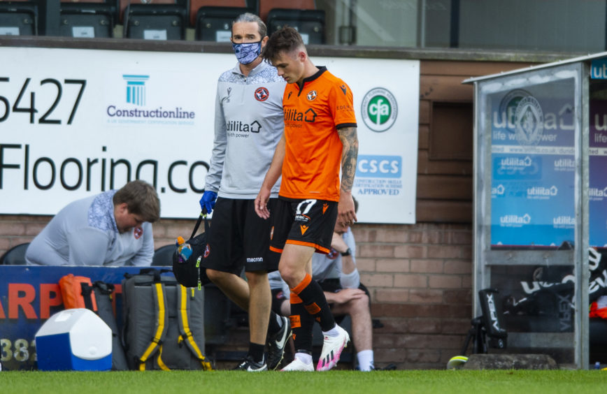 Jamie Robson goes off injured after head knock.