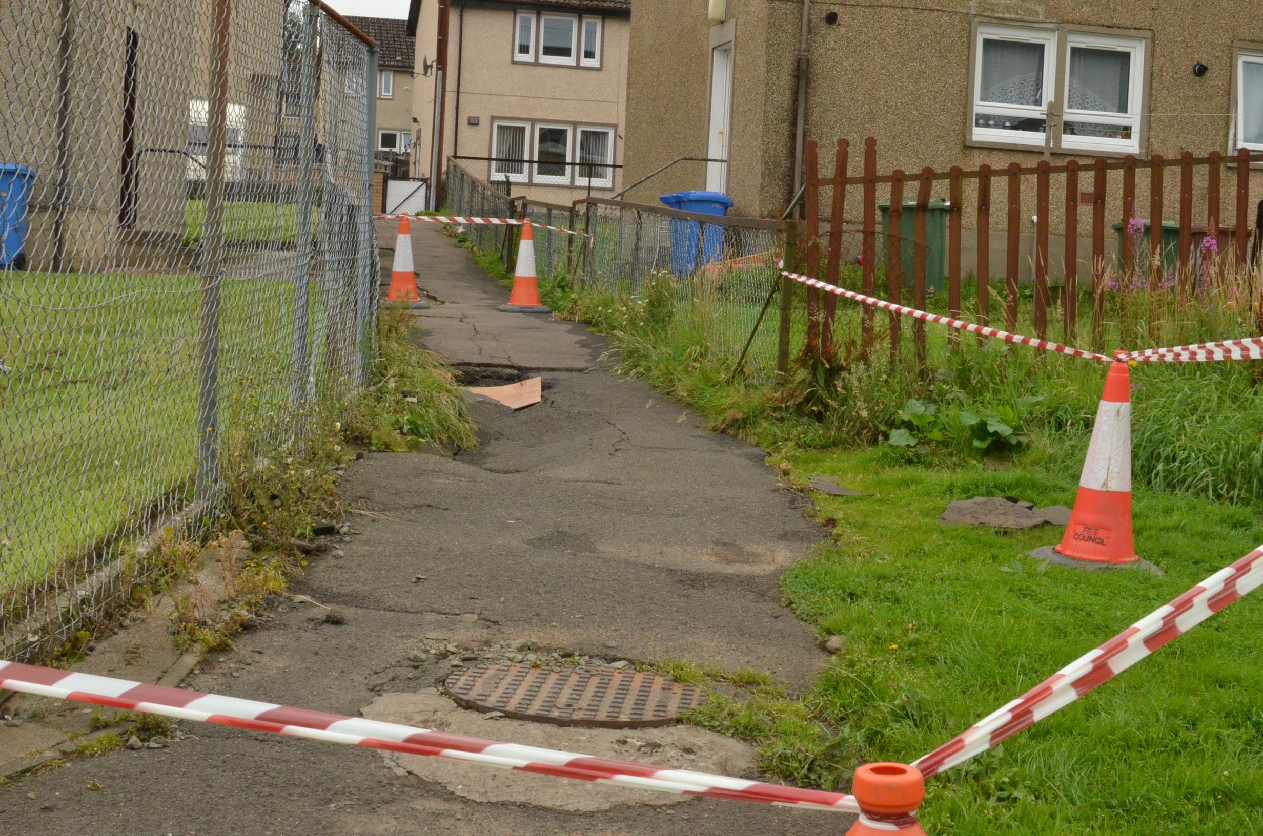 The damaged path at Kirktoun Park.