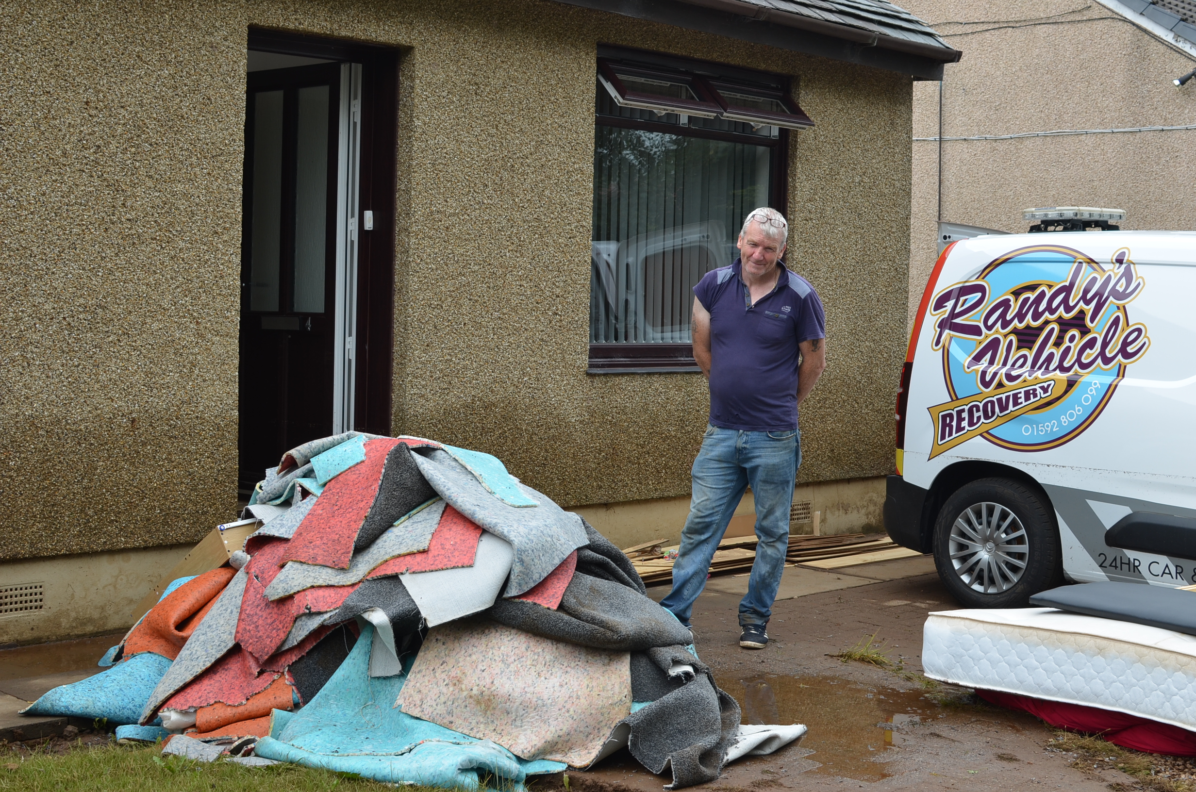 Robert Norrie, 52, clearing out his flood damaged home at Burnside Cottages.