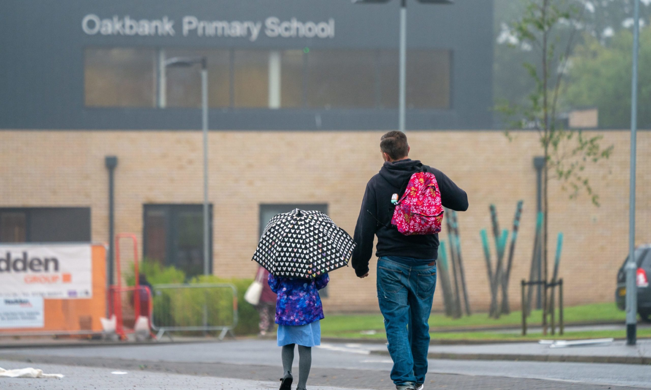 Parents dropping off pupils at Covid-hit Oakbank Primary School.