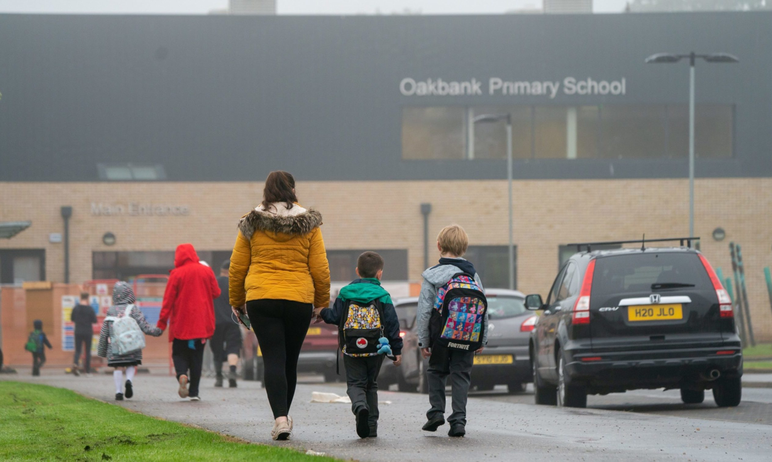 Pupils arriving at Oakbank Primary School, where one child tested positive for Covid-19 after the summer break.