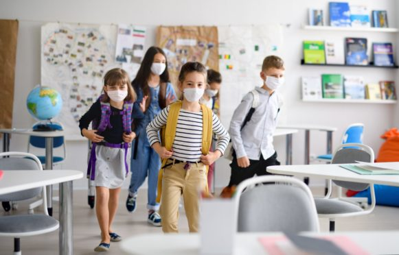 Group of children with face mask back at school after covid-19 quarantine and lockdown.; Shutterstock ID 1746069482; Purchase Order: -