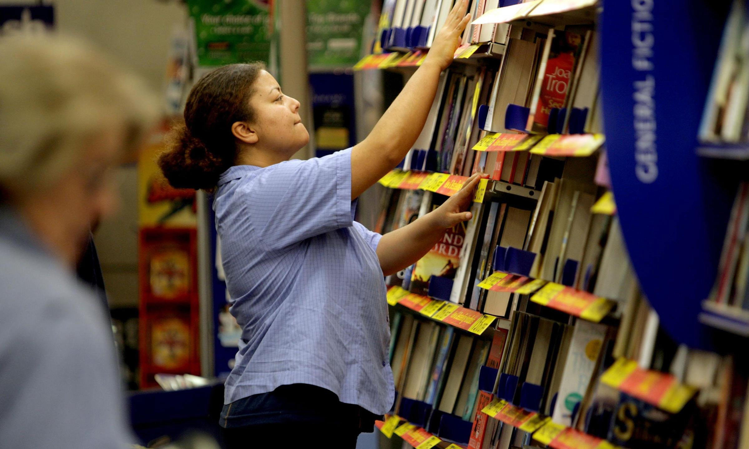 A WH Smith employee at work