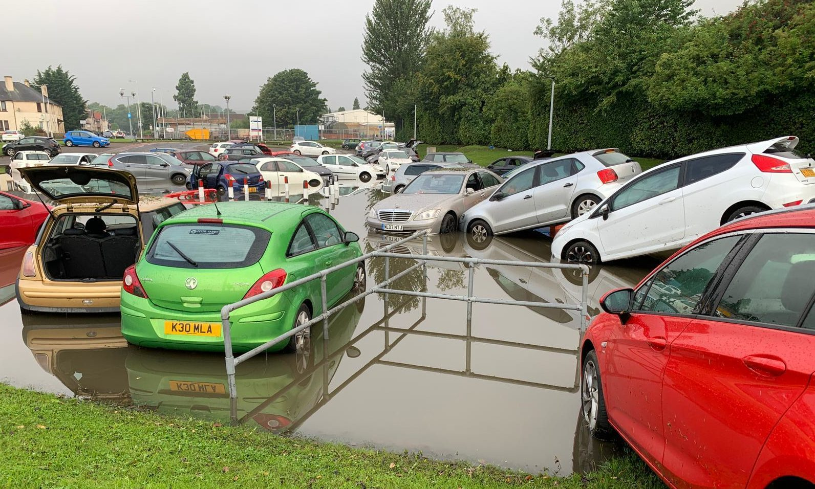 Staff cars written off at flood hit hospital car park at Victoria Hospital in August.