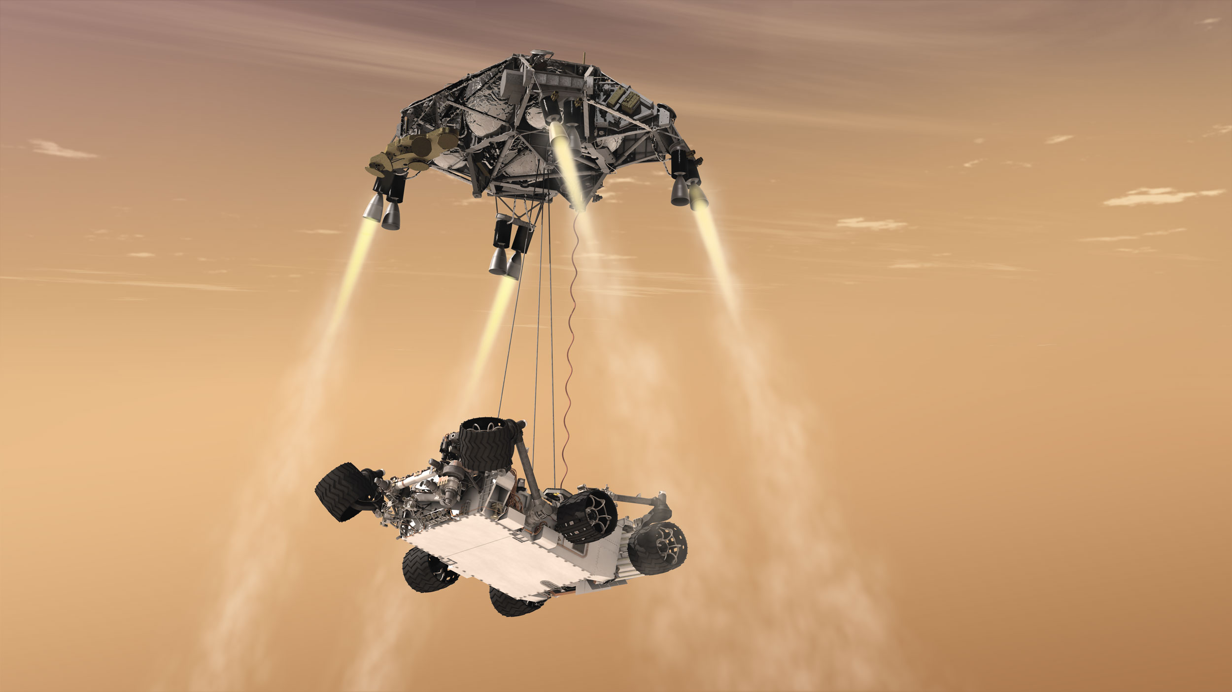 The sky crane process when the rover is dropped using cables.