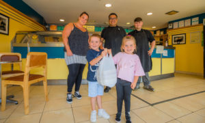 Mason and Olivia Harvey (aged 4) alongside mum Jo Harvey, Pete Chan and staff member Ciaran Cushnie. Jo and children are delivering the food to a friend that she nominated