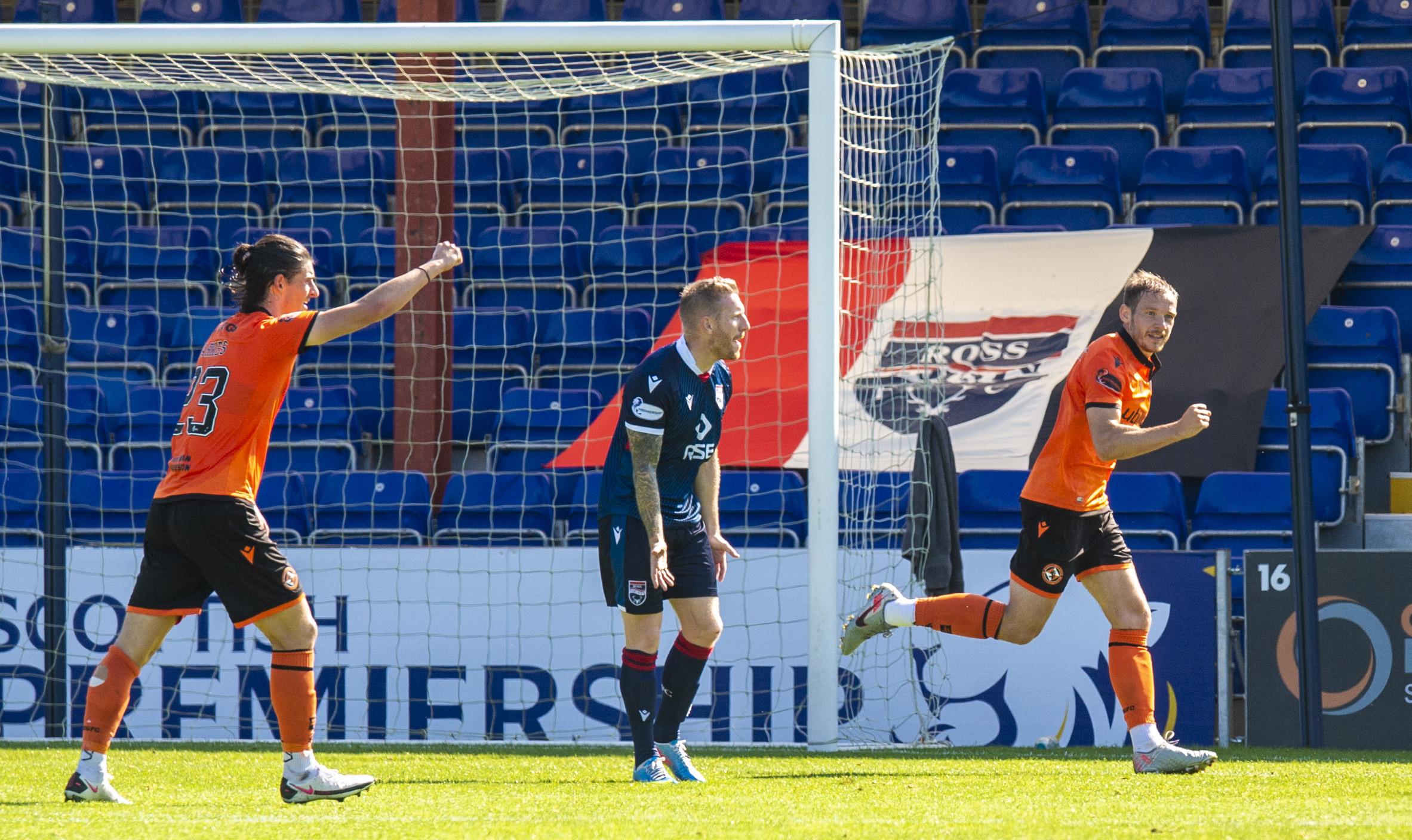 Peter Pawlett, right, celebrates his goal.