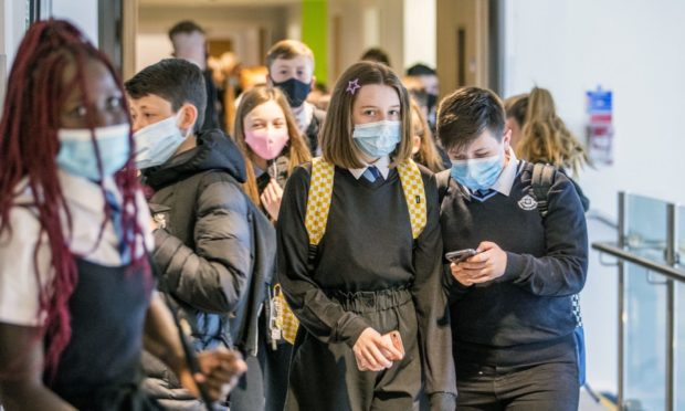 Secondary school pupils are advised to wear a face covering in communal areas and corridors