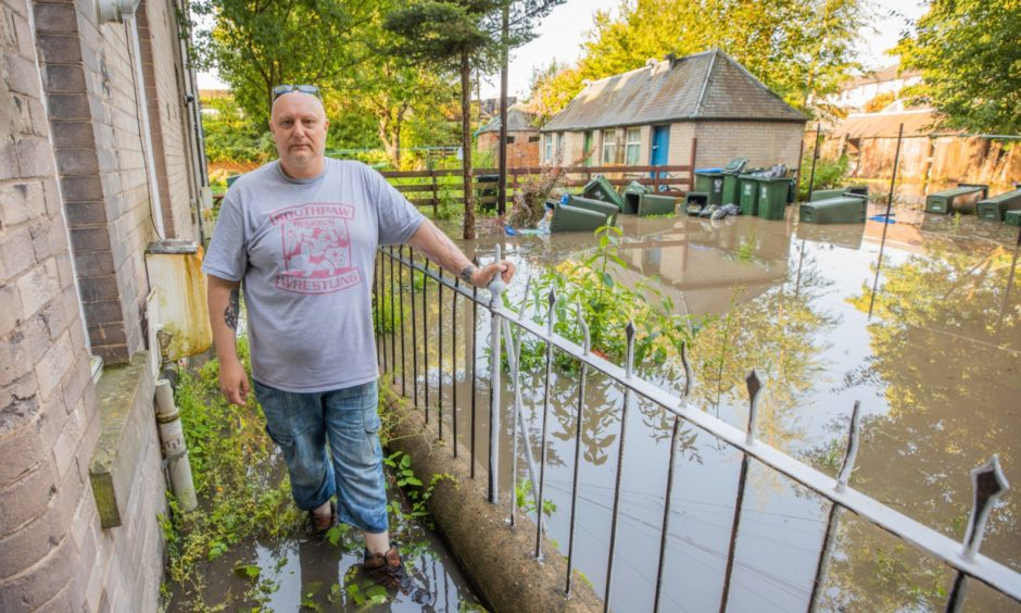 Andy Malcolm, resident at Inch Head Terrace, Perth - his ground floor flat is flooded.