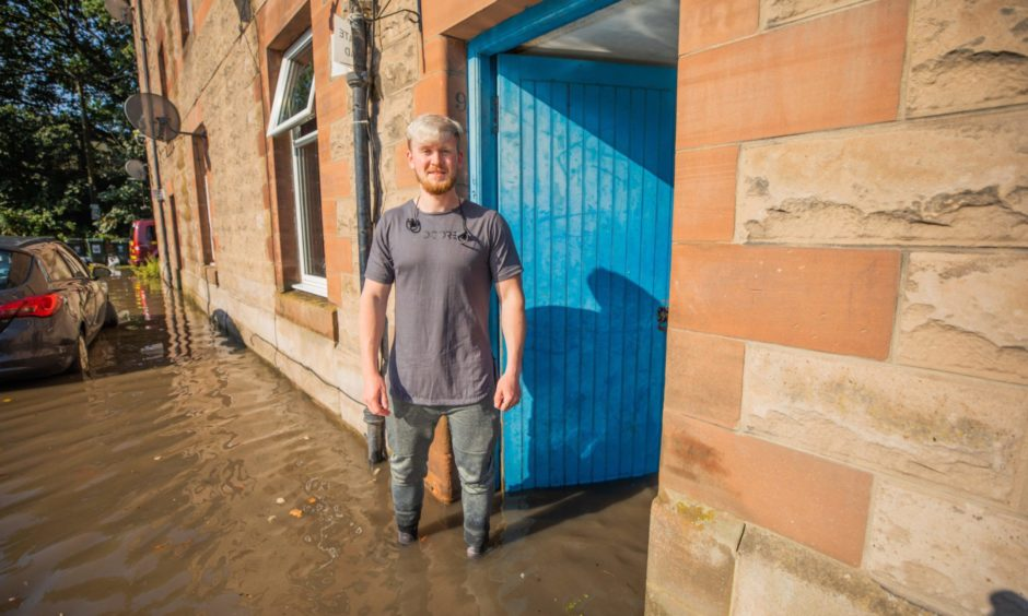 Kyle McLeish, resident at Inch Head Terrace, Perth - his ground floor flat is flooded.