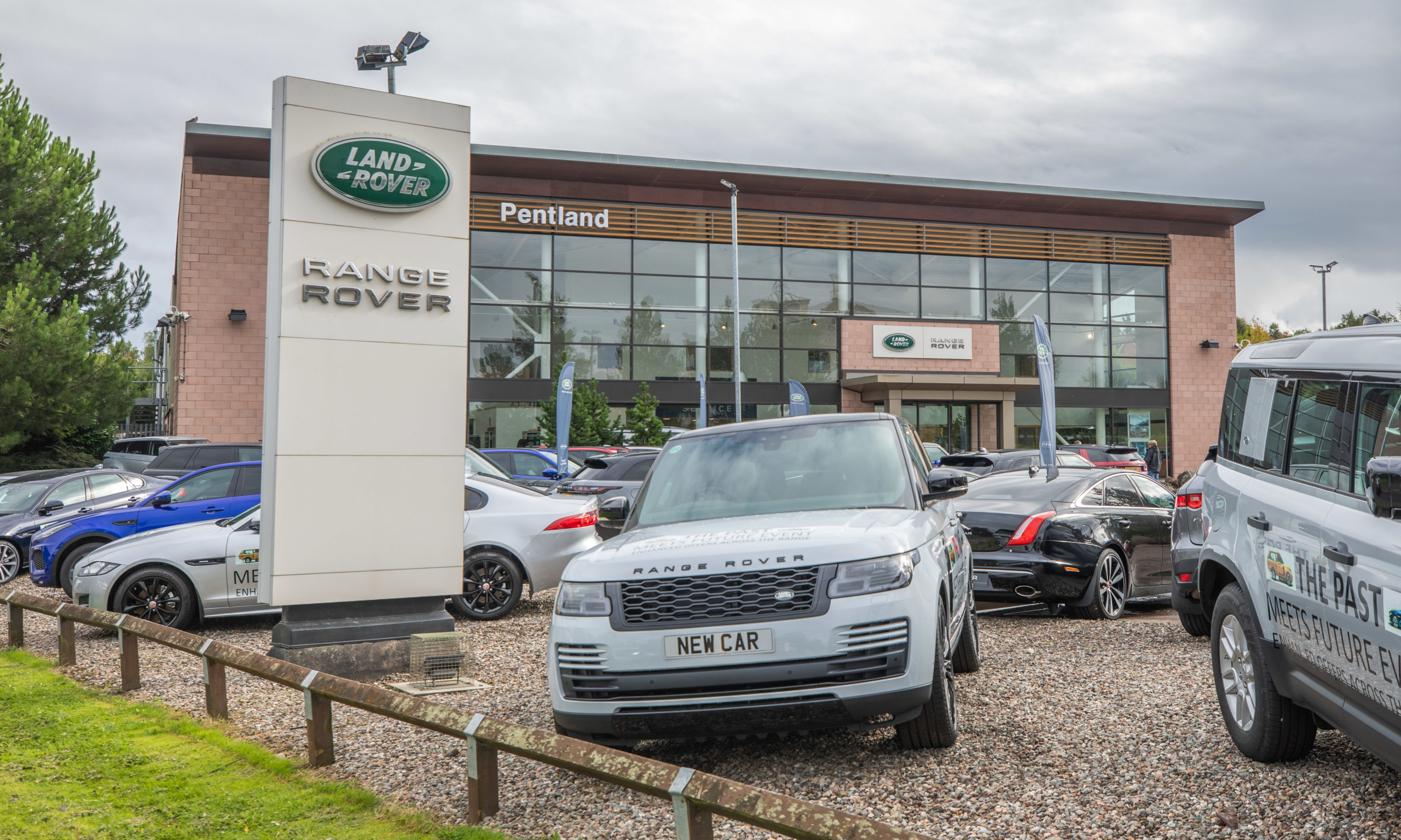 A spike of cases has been confirmed at a Land Rover dealership in Perth.