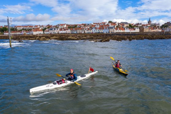 Jack Gatacre, 28, in the white kayak, and Antonio Vastano, 25, in the yellow kayak, set off from Pittenweem as part of their mammoth journey by kayak in aid of The Fishermen's Mission.