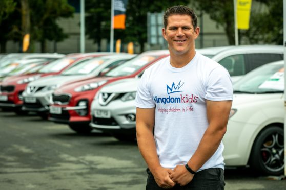 Lee Bryce, 30, is planning on running around all of Fife's High Schools in 24 hours to raise money for Kingdom Kids. Here's Lee at his work in Kirkcaldy on Friday.