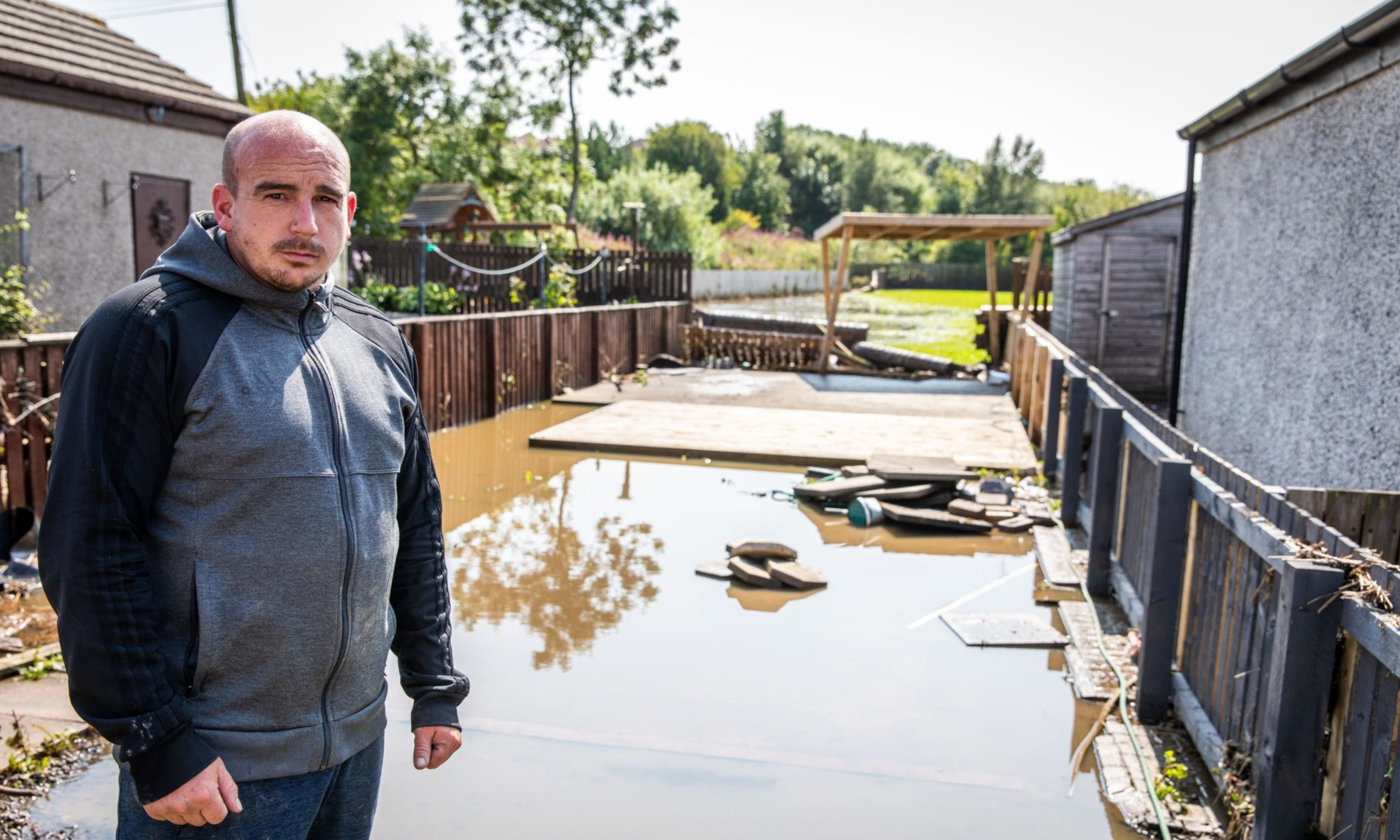 Cardenden resident Chris King surveys the damage caused by the flood water to his property in August.