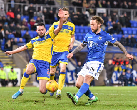Tumilty in action for Morton up against St Johnstone's Stevie May