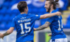 Danny McNamara helps Stevie May celebrate his goal.