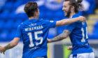 Danny McNamara helps Stevie May celebrate his goal.