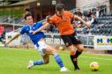 Danny McNamara closes down Dundee United's Lawrence Shankland.
