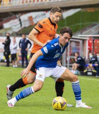 Danny McNamara shields the ball from Dundee United's Peter Pawlett.
