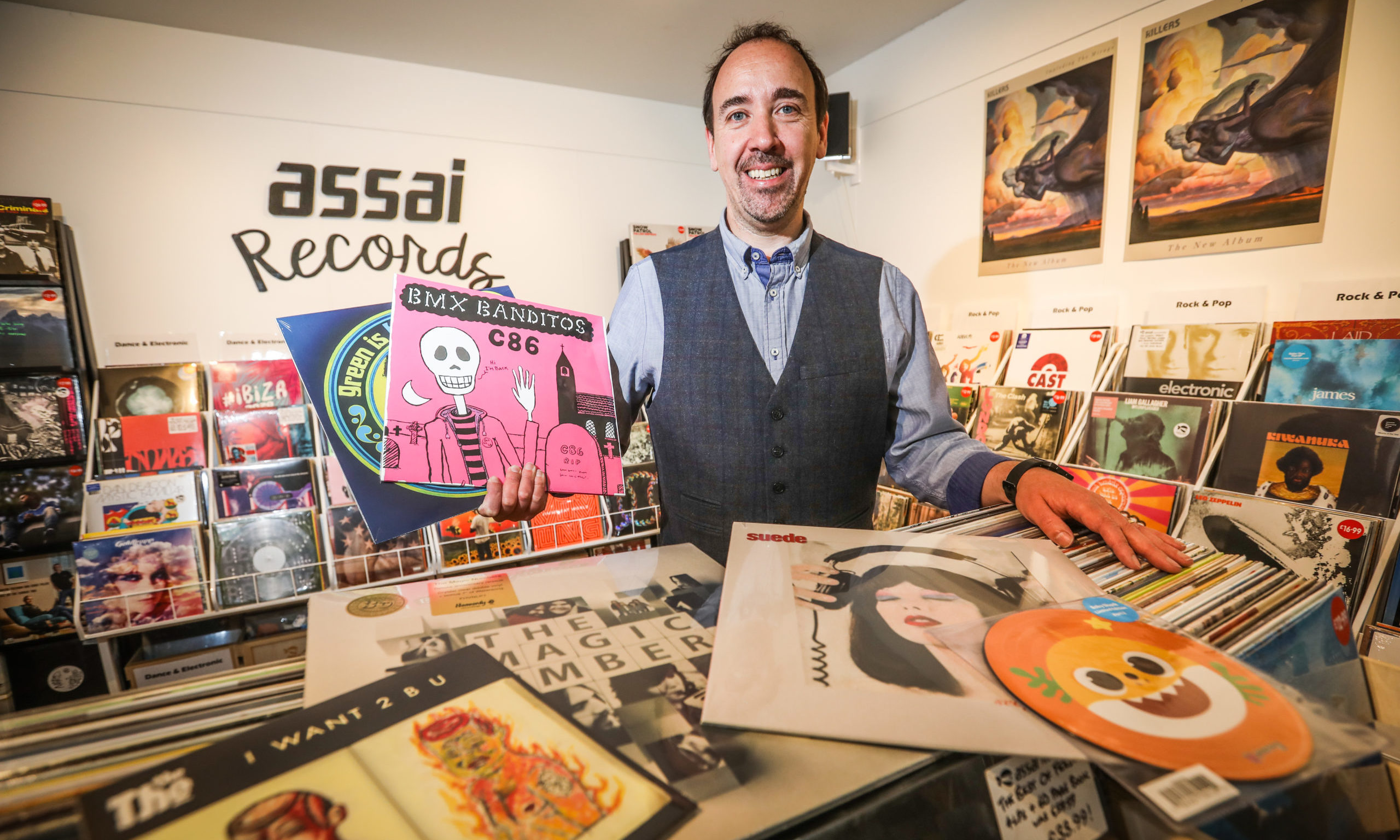 Keith Ingram, owner of Assai Records, with some of this year's Record Store Day releases.