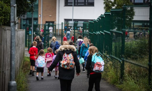 Parents drop off their children at Newhill Primary, Blairgowrie.