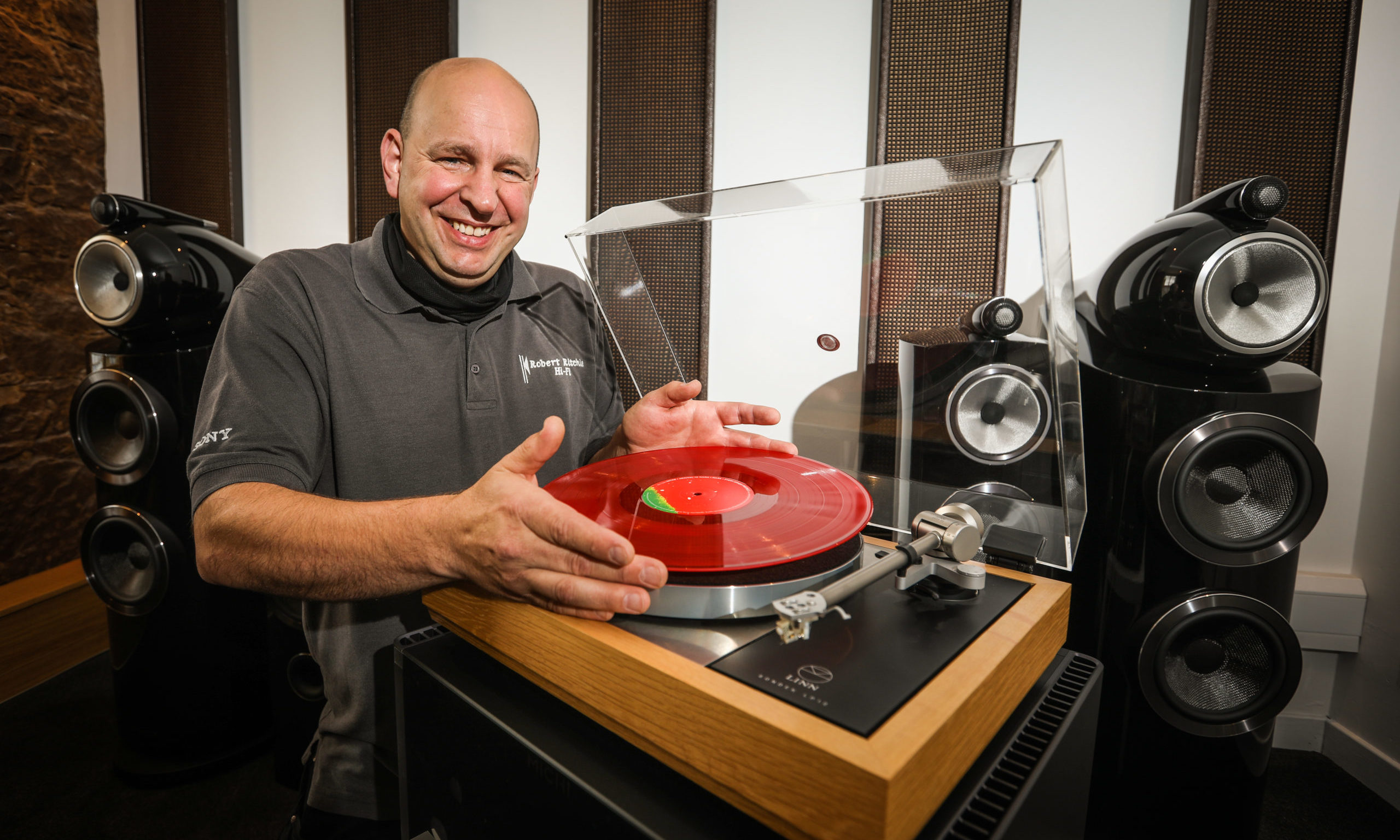 Robbie Ritchie puts a record on the £18,500 Linn Sondek LP12 turntable at his Montrose shop.