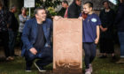 Sculptor David McGovern and litter picking champion Lily Souter who officially unveiled the stone.