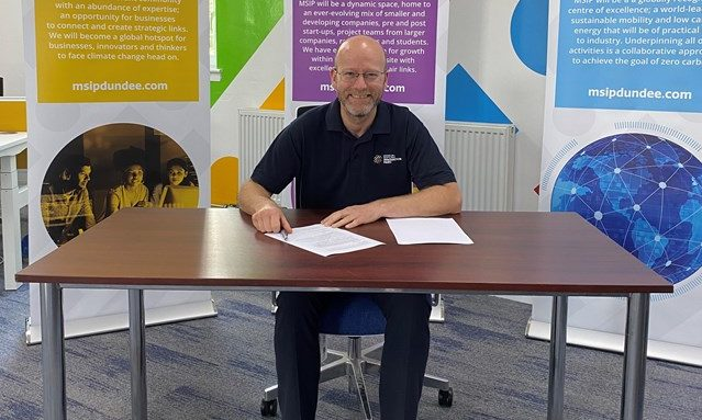 MSIP chief operating officer Colin Mcilraith signing the agreement