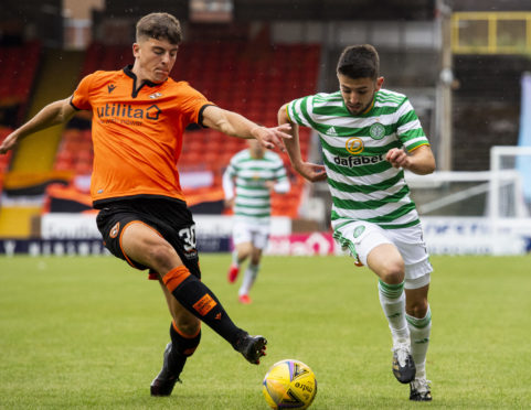 Lewis Neilson in action against Celtic.