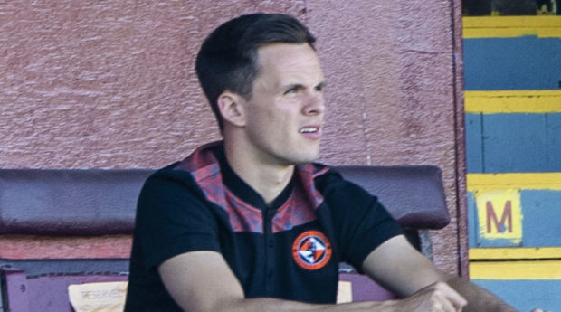 An injured Lawrence Shankland watches his teammates from the stand..