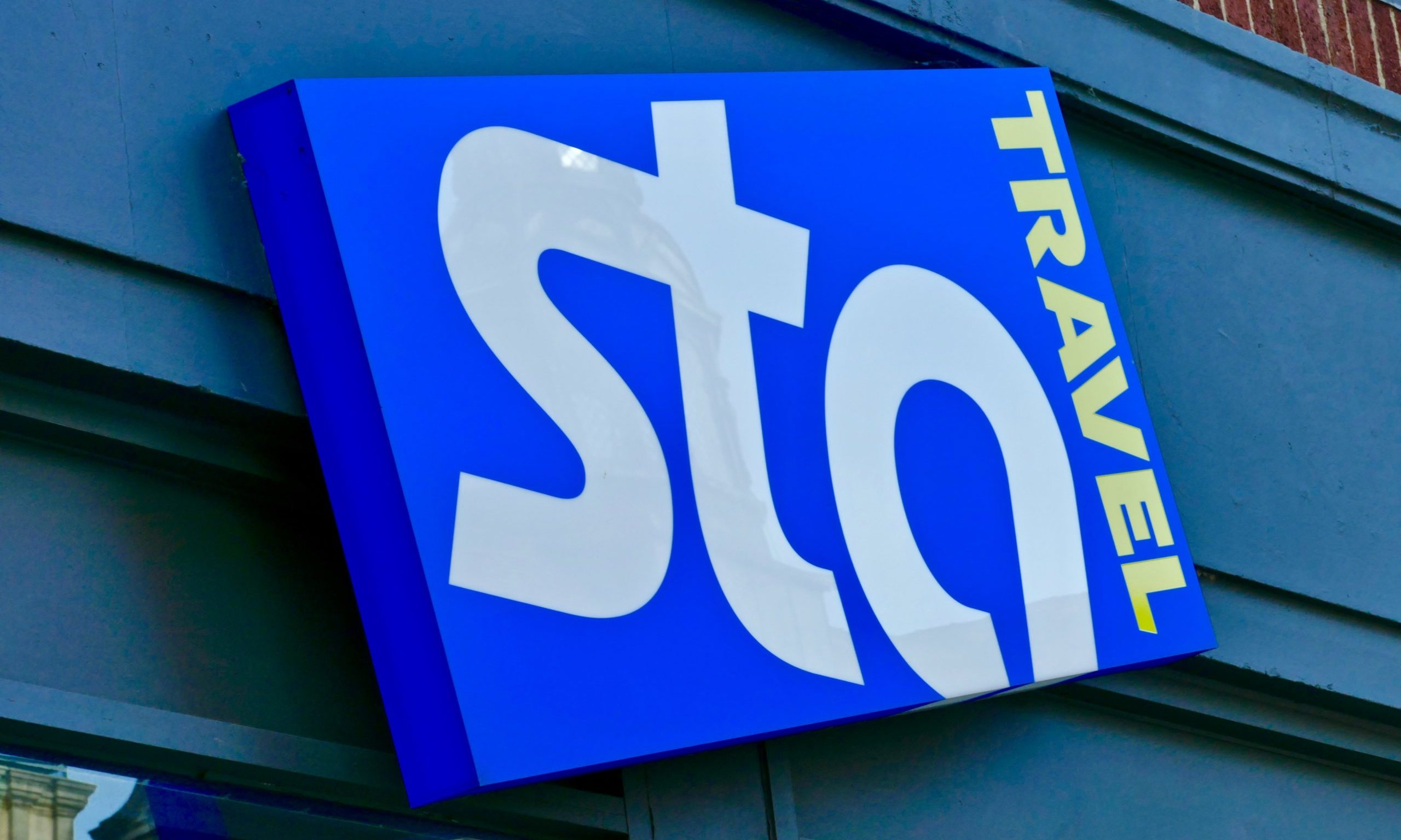 A STA Travel sign