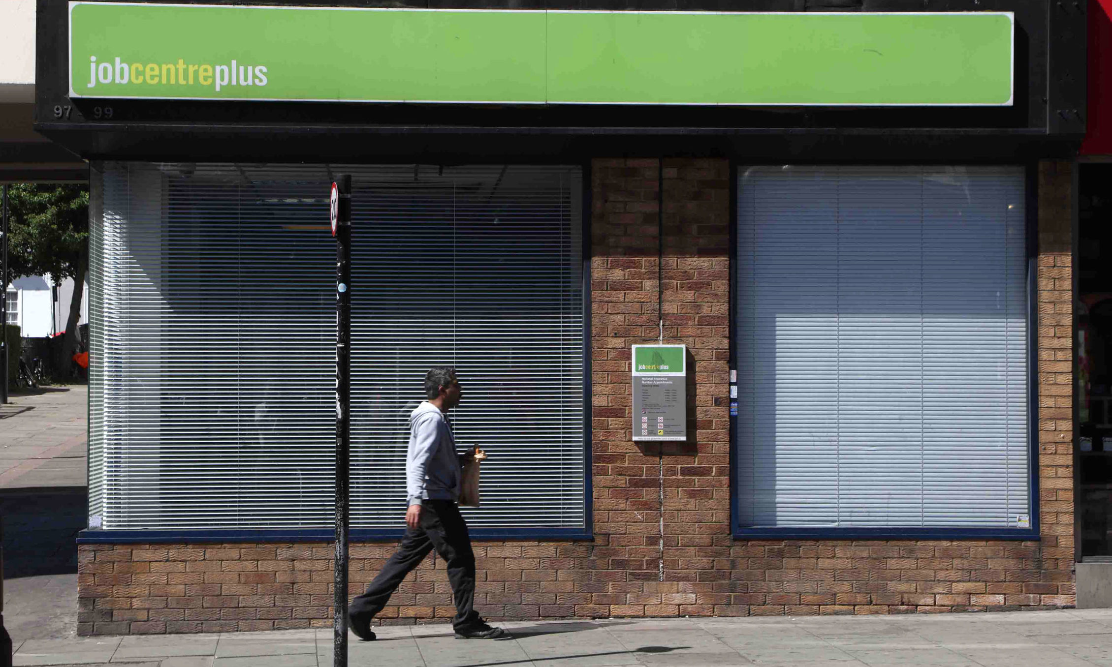 A man walks past a job centre.