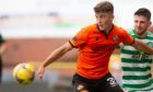 Dundee United rising star Lewis Neilson holds off Celtic's Greg Taylor.