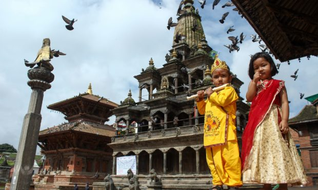 Mandatory Credit: Photo by Subash Shrestha/Shutterstock (10740700g) A Nepalese boy dressed as Hindu God Krishna (L) and girls as radha (R) on the auspicious occasion of Krishna Janmashtami festival which marks the birth of Hindu God Lord Krishna, in Patan, Lalitpur. This year devotees were not allowed to the rituals inside the Krishna temple due to Covid-19. Krishna Janmashtami Festival, Lalitpur, Nepal - 11 Aug 2020
