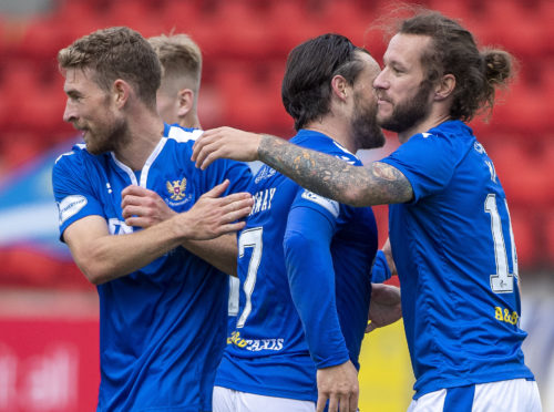 The St Johnstone players celebrate Stevie May's winning goal.