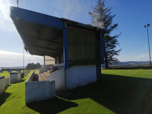 Fire creeping up the side of the Westview Park stand.